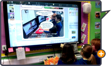 Students use Comic Life 3 collaboratively on large screen.